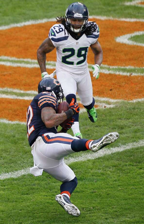 Chicago Bears running back Matt Forte (22) makes a reception for a touchdown in front of Seattle Seahawks safety Earl Thomas (29) in the second half of an NFL football game in Chicago, Sunday, Dec. 2, 2012. Photo: AP