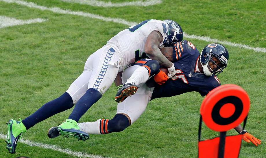 Chicago Bears wide receiver Brandon Marshall (15) is tackled by a Seattle Seahawks defender in the second half of an NFL football game in Chicago, Sunday, Dec. 2, 2012. Photo: AP