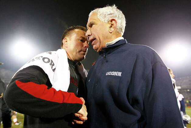 EAST HARTFORD, CT - DECEMBER 1: Head coach Butch Jones of the Cincinnati Bearcats shakes hands with head coach Paul Pasqualoni of the Connecticut Huskies following the Bearcats 34-17 win for a share of the Big East Championship title during the game at Rentschler Field on December 1, 2012 in East Hartford, Connecticut. (Photo by Jared Wickerham/Getty Images) Photo: Jared Wickerham, Getty Images / 2012 Getty Images