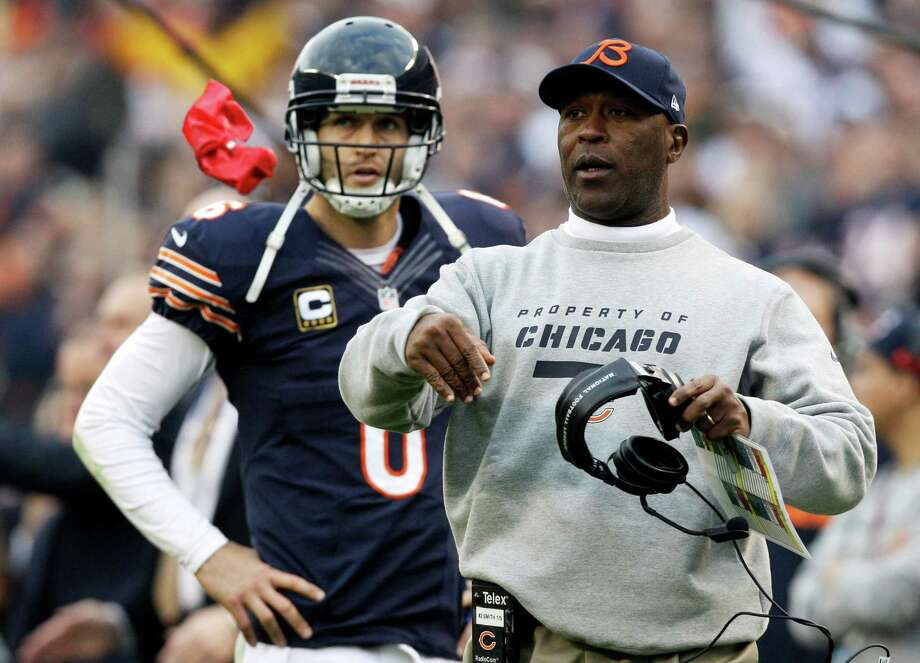 Chicago Bears head coach Lovie Smith throws a red flag to review a touchdown play in the second half against the Seattle Seahawks in an NFL football game in Chicago, Sunday, Dec. 2, 2012. The ruling went in favor of the Bears. Looking on is Bears quarterback Jay Cutler. Photo: AP
