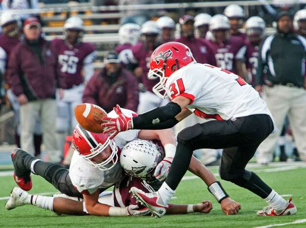 New Canaan high school defensive back Michael DiCosmo picks up a fumble in the fourth quarter of the CIAC class L semifinal football tournament game against  Windsor high school and runs it in for a touchdown. The game was played at Bunnell high school, Stratford, CT on Sunday December 2nd, 2012. Photo: Mark Conrad / Stamford Advocate Freelance