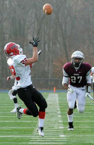 New Canaan high school's Cole Turpin catches a pass from quarterback Teddy Bossidy which he ran in for a touchdown in the CIAC class L semifinal football tournament game against Windsor high school played at Bunnell high school, Stratford, CT on Sunday December 2nd, 2012. Photo: Mark Conrad / Stamford Advocate Freelance