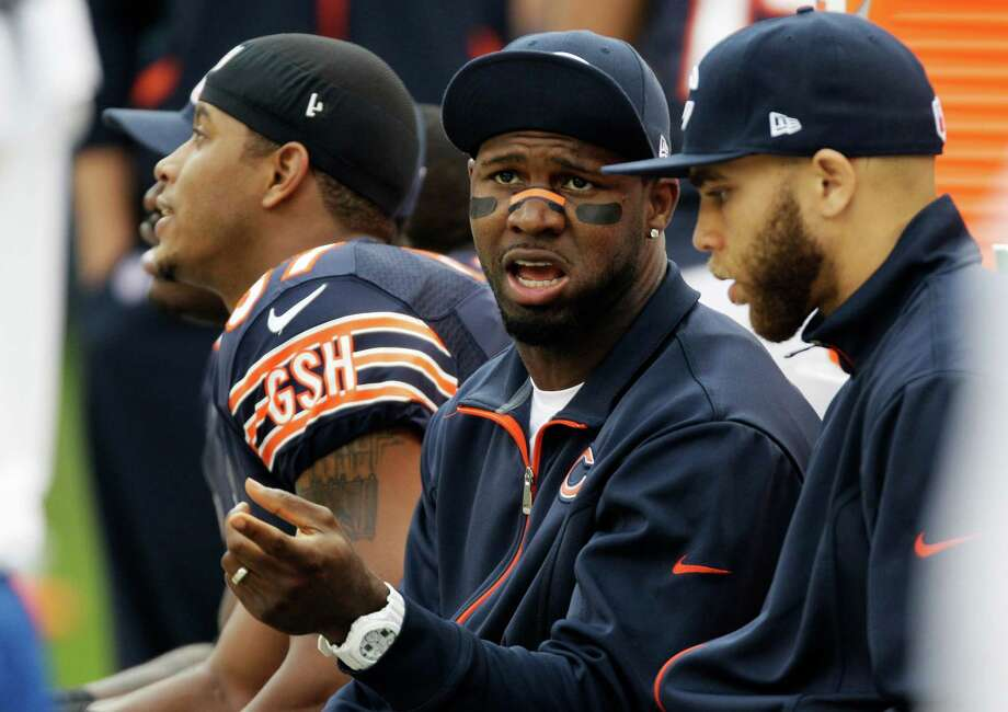 Injured Chicago Bears wide receivers Devin Hester, center, and Johnny Knox, right, talk on he bench in the second half of an NFL football game against the Seattle Seahawks in Chicago, Sunday, Dec. 2, 2012. Photo: AP