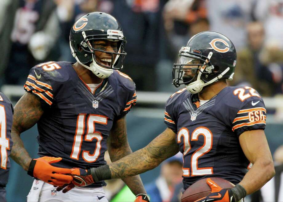 Chicago Bears running back Matt Forte (22) celebrates his touchdown reception with teammate Brandon Marshall (15) in the second half of an NFL football game against the Seattle Seahawks in Chicago, Sunday, Dec. 2, 2012. Photo: AP