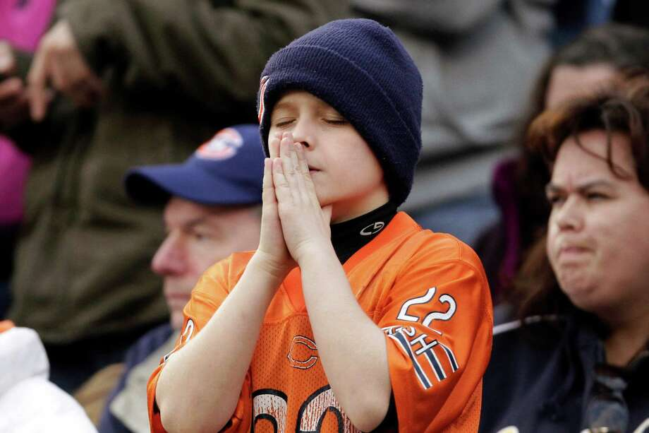 A young Chicago Bears fan gestures during the fourth quarter of an NFL football game against the Seattle Seahawks in Chicago, Sunday, Dec. 2, 2012. The Seahawks won 23-17 in overtime. Photo: AP