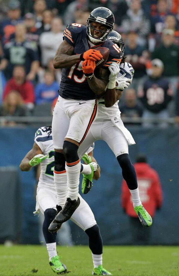 Chicago Bears wide receiver Brandon Marshall (15) makes a catch against Seattle Seahawks cornerback Richard Sherman (25) in the second half of an NFL football game in Chicago, Sunday, Dec. 2, 2012. The catch was a key play in setting up a game-tying field goal to send the game into overtime. Photo: AP