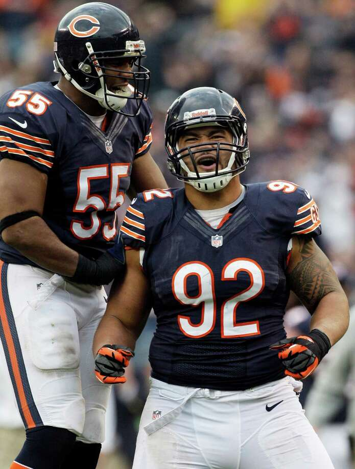 Chicago Bears defensive tackle Stephen Paea (92) celebrates after his sack against the Seattle Seahawks with teammate Lance Briggs (55) during the second half of an NFL football game in Chicago, Sunday, Dec. 2, 2012. Photo: AP