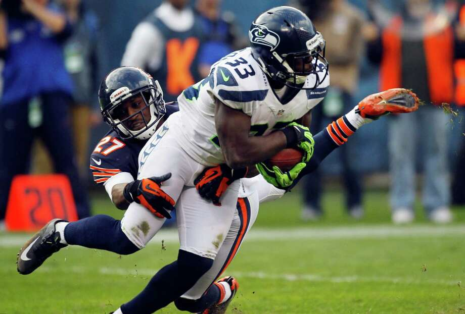 Seattle Seahawks running back Leon Washington (33) is tackled by Chicago Bears defensive back Sherrick McManis (27) in the second half of an NFL football game in Chicago, Sunday, Dec. 2, 2012. Photo: AP