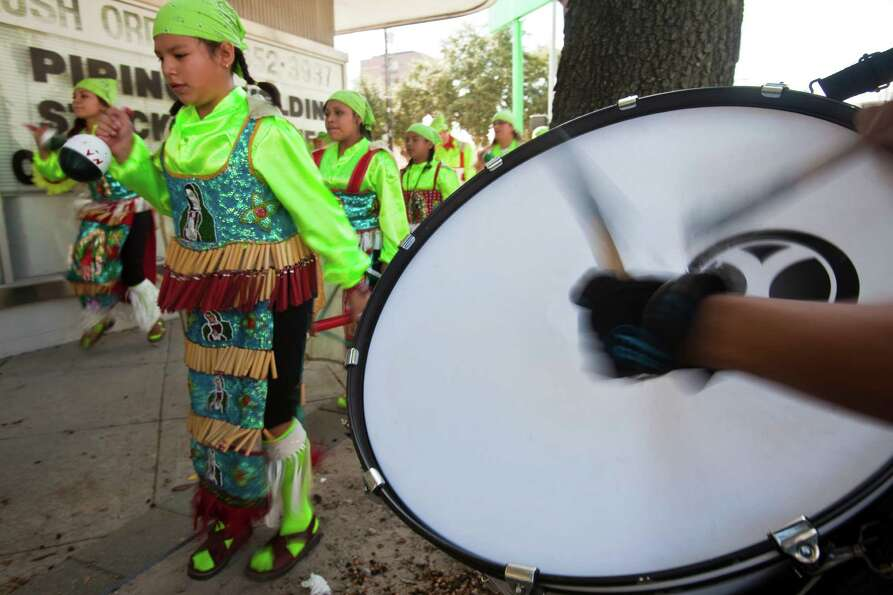 A matachines group warms up before a parade Dec. 2, 2012 in Houston. in an expression of devotion an