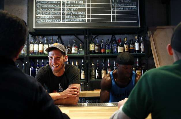 Co-owner Jesse Woodward (left) talks to customers at the bar at Hi Tops, at the site of the former Lime on Market Street. Photo: Sarah Rice, Special To The Chronicle