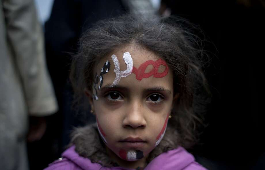 "A girl has the Egyptian national flag and the Arabic words for ""Egypt, Morsi"" painted on her face at a demonstration in front of Egypt's top court. Photo: Nasser Nasser, Associated Press"