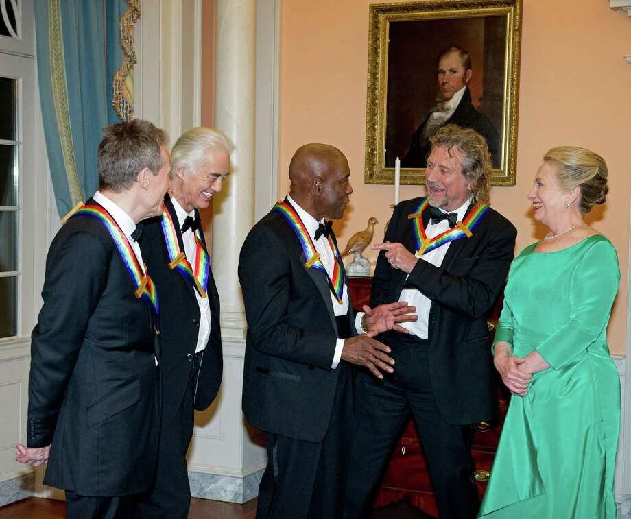 (L-R) John Paul Jones, Jimmy Page, Robert Plant of Led Zeppelin and Buddy Guy (C) talk with U.S. Secretary of State Hillary Clinton as they prepare to pose for a photograph following a dinner for Kennedy honorees hosted by the U.S. Secretary at the U.S. Department of State on December 1, 2012 in Washington, DC. The 2012 honorees are Buddy Guy, actor Dustin Hoffman, late-night host David Letterman, dancer Natalia Makarova, and members of the British rock band Led Zeppelin Robert Plant, Jimmy Page, and John Paul Jones. Photo: Pool, Getty Images / 2012 Getty Images