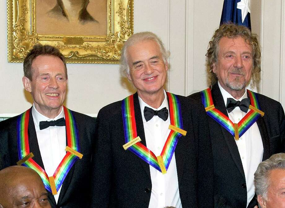 (L-R) John Paul Jones, Jimmy Page and Robert Plant of Led Zepplin, three of the seven recipients of the 2012 Kennedy Center Honors, pose for a photograph following a dinner for Kennedy honorees hosted by U.S. Secretary of State Hillary Rodham Clinton at the U.S. Department of State on December 1, 2012 in Washington, DC. The 2012 honorees are Buddy Guy, actor Dustin Hoffman, late-night host David Letterman, dancer Natalia Makarova, and members of the British rock band Led Zeppelin Robert Plant, Jimmy Page, and John Paul Jones. Photo: Pool, Getty Images / 2012 Getty Images