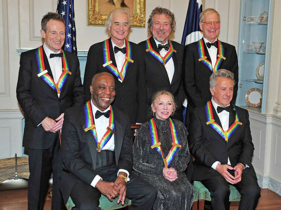(L-R Back Row)  John Paul Jones, Jimmy Page, Robert Plant, David Letterman (L-R Front Row) U.S. Secretary of State Hillary Rodham Clinton, Buddy Guy, Natalia Makarova, Dustin Hoffman pose following a dinner for Kennedy honorees hosted by U.S. Secretary of State Hillary Rodham Clinton at the U.S. Department of State on December 1, 2012 in Washington, DC. Photo: Pool, Getty Images / 2012 Getty Images