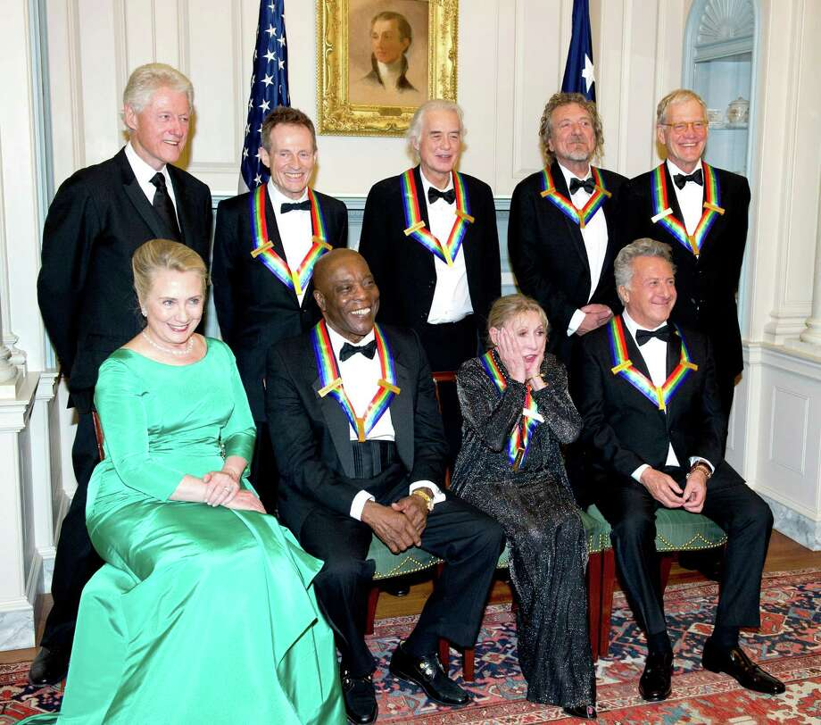 (L-R Back Row)  Former U.S. President Bill Clinton, John Paul Jones, Jimmy Page, Robert Plant, David Letterman (L-R Front Row)  U.S. Secretary of State Hillary Rodham Clinton, Buddy Guy, Natalia Makarova and Dustin Hoffman pose for a photograph following a dinner for Kennedy honorees hosted by U.S. Secretary of State Hillary Rodham Clinton at the U.S. Department of State on December 1, 2012 in Washington, DC. The 2012 honorees are Buddy Guy, actor Dustin Hoffman, late-night host David Letterman, dancer Natalia Makarova, and members of the British rock band Led Zeppelin Robert Plant, Jimmy Page, and John Paul Jones. Photo: Pool, Getty Images / 2012 Getty Images