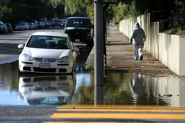 A large puddle of standing water is seen on the corner of Gough and Golden Gate in San Francisco.  A series of storms passed through the Bay Area on Sunday December 2nd, 2012, dumping rain accompanied by high winds. Photo: Michael Short, Special To The Chronicle