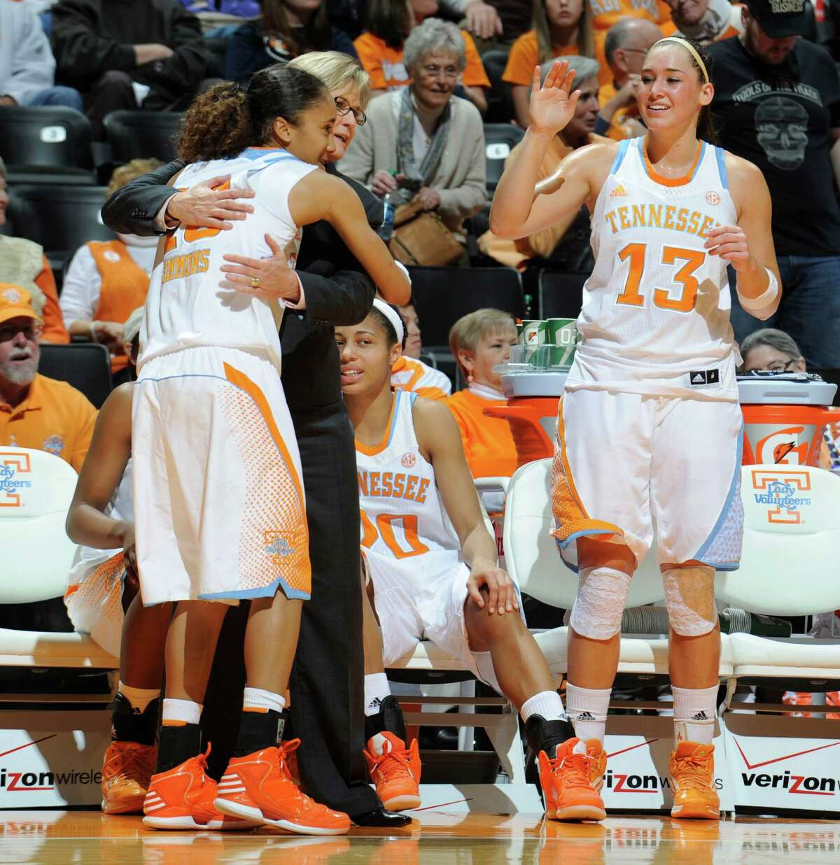 Tennessee's Meighan Simmons, left, is congratulated by head coach Holly Warlick as she comes to the bench after scoring a career-high 33 points against North Carolina during an NCAA college basketball game at Thompson-Boling Arena in Knoxville, Tenn., Sunday, Dec. 2, 2012. Tennessee won the game 102-57. (AP Photo/The Knoxville News Sentinel, Amy Smotherman Burgess)