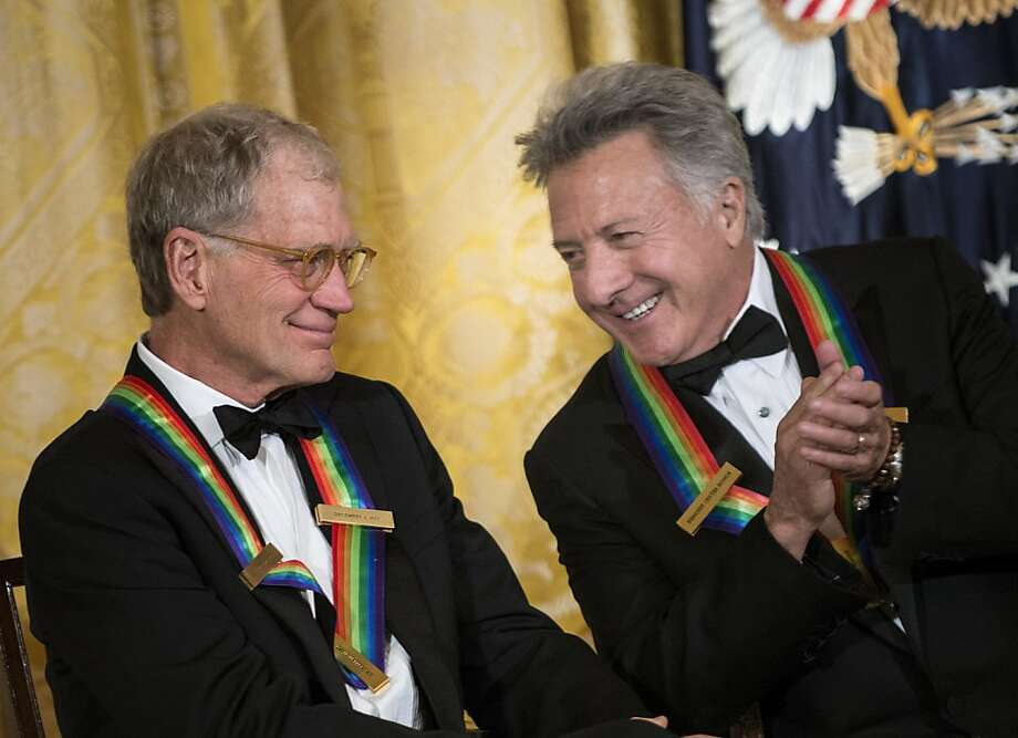 Kennedy Center Honors recipients David Letterman and Dustin Hoffman chat during an East Room ceremony. Also honored were Led Zeppelin, blues man Buddy Guy and ballerina Natalia Makarova. Photo: Brendan Smialowski, AFP/Getty Images