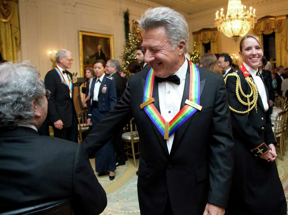 Actor and director Dustin Hoffman, 2012 Kennedy Center Honors recipient, center, leaves a reception hosted by President Barack Obama and first lady Michelle Obama for the honorees in the East Room of the White House in Washington, Sunday, Dec. 2, 2012. (AP Photo/Manuel Balce Ceneta) Photo: Manuel Balce Ceneta, Associated Press / AP