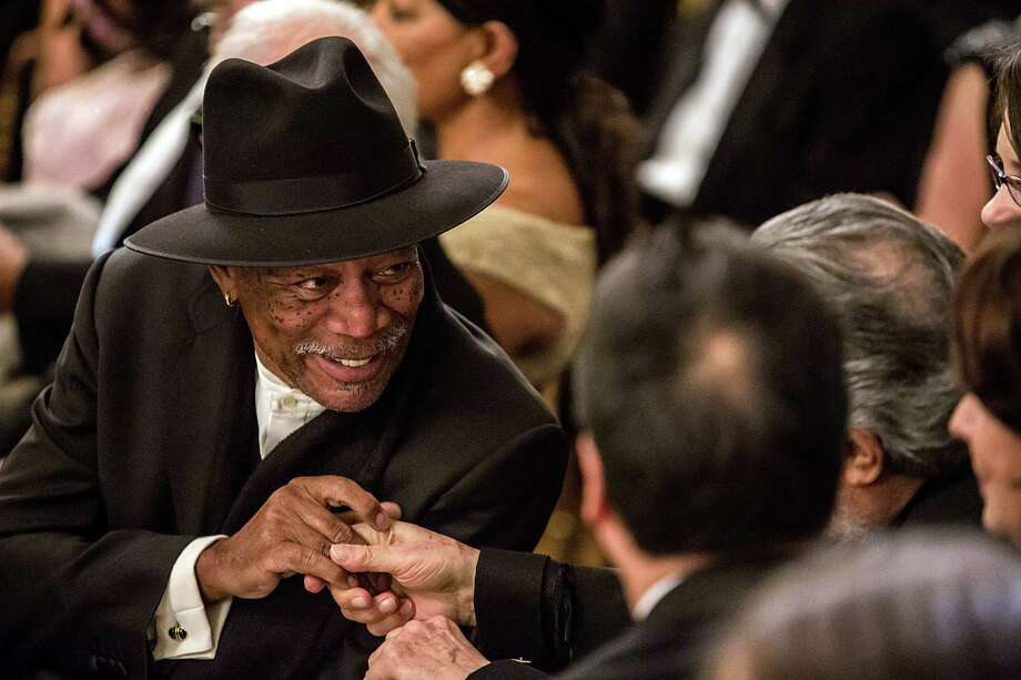 Actor Morgan Freeman greets another guest at the Kennedy Center Honors reception at the White House on December 2, 2012 in Washington, DC. The Kennedy Center Honors recognized seven individuals - Buddy Guy, Dustin Hoffman, David Letterman, Natalia Makarova, John Paul Jones, Jimmy Page, and Robert Plant - for their lifetime contributions to American culture through the performing arts. Photo: Brendan Hoffman, Getty Images / 2012 Getty Images