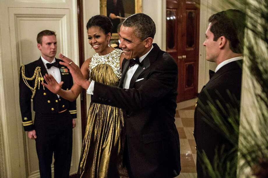 President Barack Obama and First Lady Michelle Obama arrive at the Kennedy Center Honors reception at the White House on December 2, 2012 in Washington, DC. The Kennedy Center Honors recognized seven individuals - Buddy Guy, Dustin Hoffman, David Letterman, Natalia Makarova, John Paul Jones, Jimmy Page, and Robert Plant - for their lifetime contributions to American culture through the performing arts. Photo: Brendan Hoffman, Getty Images / 2012 Getty Images