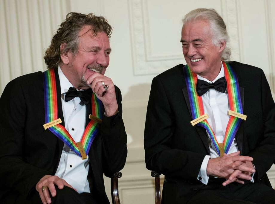 Led Zeppelin band members Robert Plant (L) and Jimmy Page listen during an event in the East Room of the White House December 2, 2012 in Washington, DC. US President Barack Obama and First Lady Michelle Obama attended the event at the White House with the 2012 Kennedy Center Honorees to celebrate their contribution to the arts before heading to the Kennedy Center for the honors program.    AFP PHOTO/Brendan SMIALOWSKIBRENDAN SMIALOWSKI/AFP/Getty Images Photo: BRENDAN SMIALOWSKI, AFP/Getty Images / 2012 Brendan Smialowski