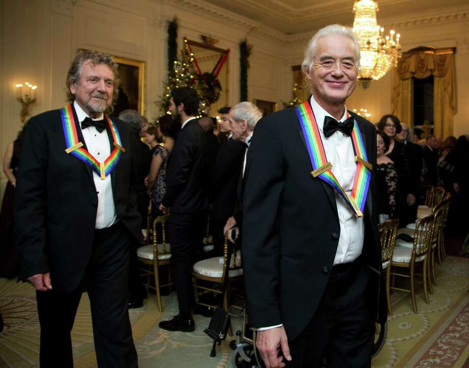 The 2012 Kennedy Center Honors recipients, rock band Led Zeppelin, guitarist Jimmy Page, right, and singer Robert Plant, leave a reception hosted by President Barack Obama and first lady Michelle Obama for the honorees in the East Room of the White House in Washington, Sunday, Dec. 2, 2012.  (AP Photo/Manuel Balce Ceneta) Photo: Manuel Balce Ceneta, Associated Press / AP