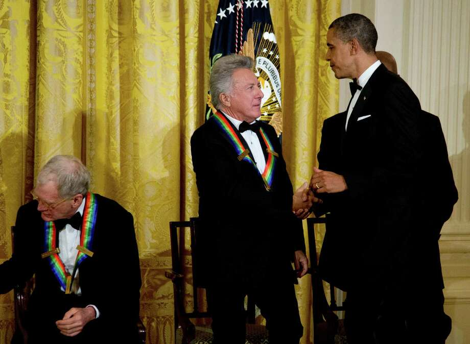 President Barack Obama, right, shakes hands with 2012 Kennedy Center Honors recipient actor and director Dustin Hoffman, center, during a reception hosted by President Barack Obama and first lady Michelle Obama for the honorees in the East Room of the White House in Washington, Sunday, Dec. 2, 2012. On the left is honoree David Letterman. (AP Photo/Manuel Balce Ceneta) Photo: Manuel Balce Ceneta, Associated Press / AP