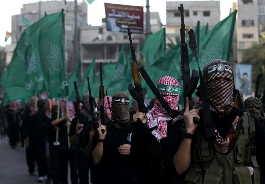 Militiamen with the Izzedine Qassam Brigades, the military wing of Hamas, mark the 25th anniversary of Hamas' founding with a march in the Gaza Strip Dec. 2, days after the most recent fighting with Israel ended. Photo: Hatem Moussa, Associated Press