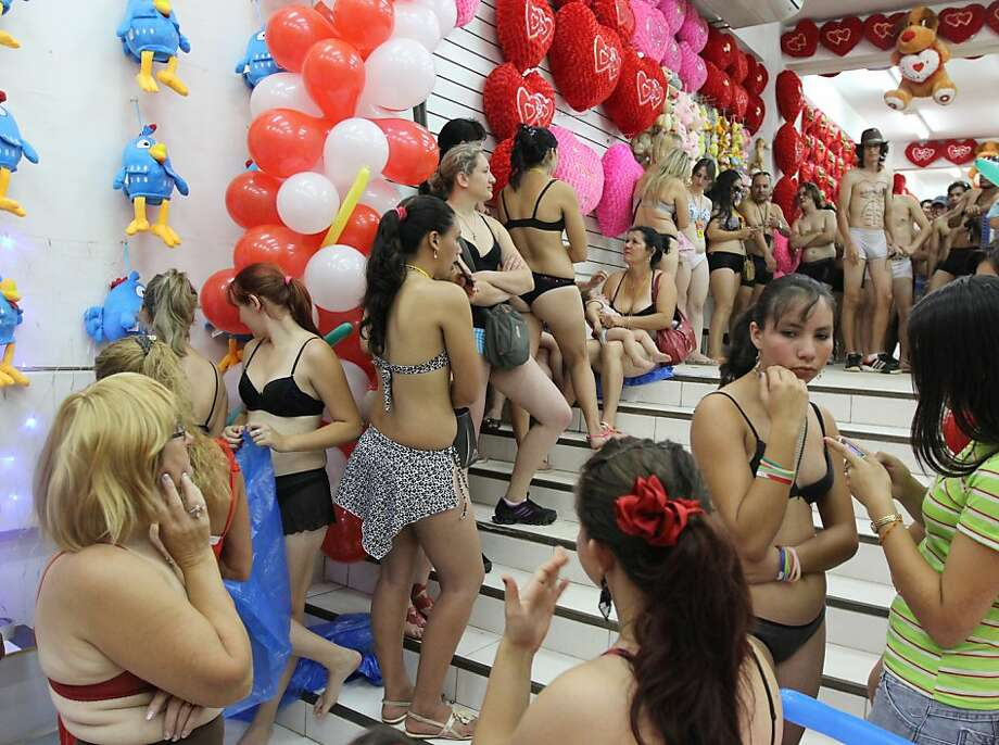 Show some skin, pay less: Customers strip to bras and panties for special promotion guaranteeing the underdressed great deals at a mall in Ciudad del Este, Paraguay. Photo: Jose Espinola, AFP/Getty Images