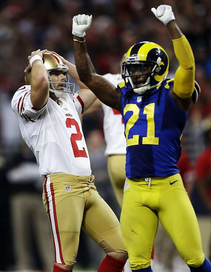 David Akers and St. Louis' Janoris Jenkins have opposite reactions after Akers' 51-yard field-goal attempt with 4:16 remaining in overtime missed just to the right. Photo: Jeff Roberson, Associated Press