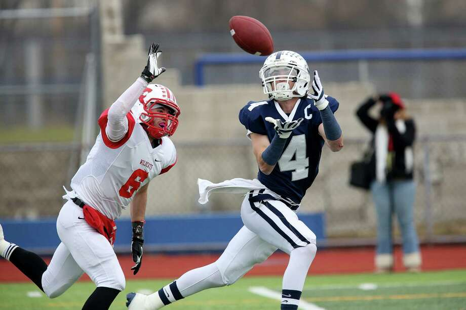 Mike Ross Connecticut Post freelance -Staples High School's #4 James Frusciante eyes a long pass which lead to Staples first touchdown against Norwich Free Academy's #6 John Caruso during Sunday Class LL football semifinals. NFA would win 30-28. Photo: Mike Ross / Connecticut Post Freelance