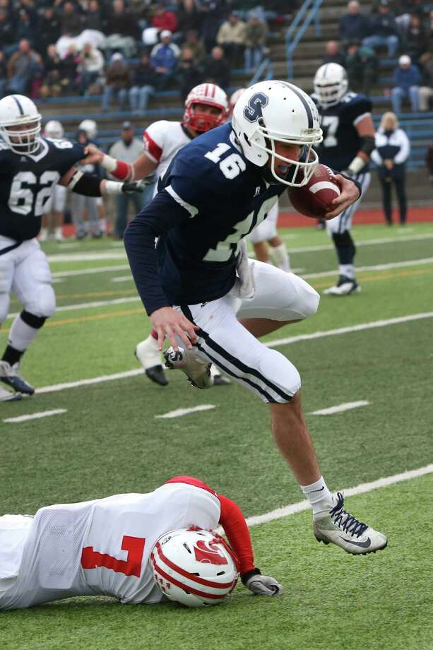 Mike Ross Connecticut Post freelance -Staples High School's quarterback #16 Jack Massie leaps over a defender into the endzone for a touchdown during Sunday afternoon match up against Norwich Free Academy for the Class LL football semifinals. NFA would win 30-28. Photo: Mike Ross / Connecticut Post Freelance