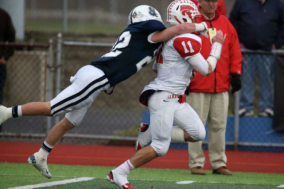 Mike Ross Connecticut Post freelance -Staples High School's #22 Joey Zelkowitz gives chase and brings down Norwich Free Academy's #11 Joey Paparelli on Sunday afternoon for the Class LL football semifinals. NFA would win 30-28. Photo: Mike Ross / Connecticut Post Freelance