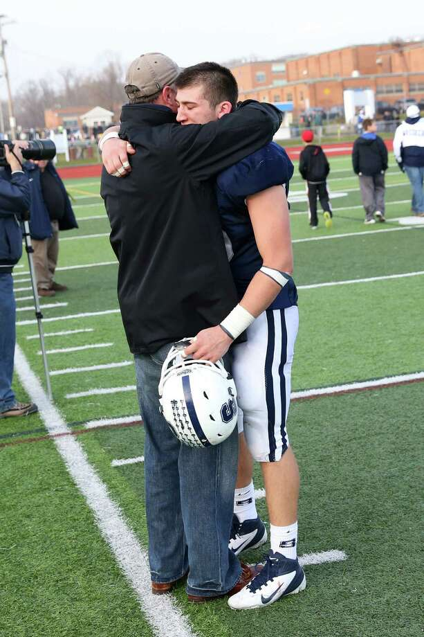 Mike Ross Connecticut Post freelance -Staples High School's #18 Richard Eldh reflects with father  during Sunday afternoon match up against Norwich Free Academy for the Class LL football semifinals. NFA would win 30-28. Photo: Mike Ross / Connecticut Post Freelance