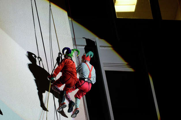 Brian Cashman, left, in red, and Bobby Valentine, in stripes, rappel down the side of the Landmark Building in downtown Stamford, CT. They joined Santa, Rudolph and Mrs. Claus in a holiday rappelling celebration on Dec. 2, 2012. Photo: Shelley Cryan / Shelley Cryan for the Stamford Advocate/ freelance Shelley Cryan