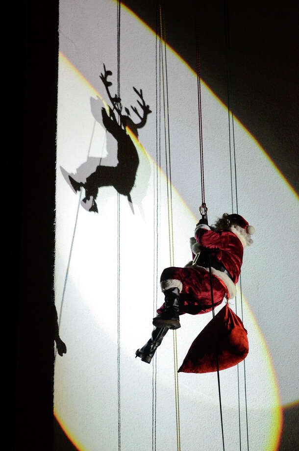 Santa rappels down the side of the Landmark Building in downtown Stamford, CT. He joined Bobby Valentine, Brian Cashman, Rudolph and Mrs. Claus in a holiday rappelling celebration on Dec. 2, 2012. Photo: Shelley Cryan / Shelley Cryan for the Stamford Advocate/ freelance Shelley Cryan