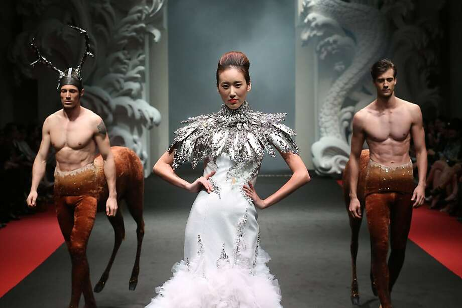 Centaurs of attention:Accompanied by her stable, a model showcases a creation by French fashion designer On Aura Tout Vu during the French Couture 2012 Singapore fashion show. Photo: Wong Maye-E, Associated Press