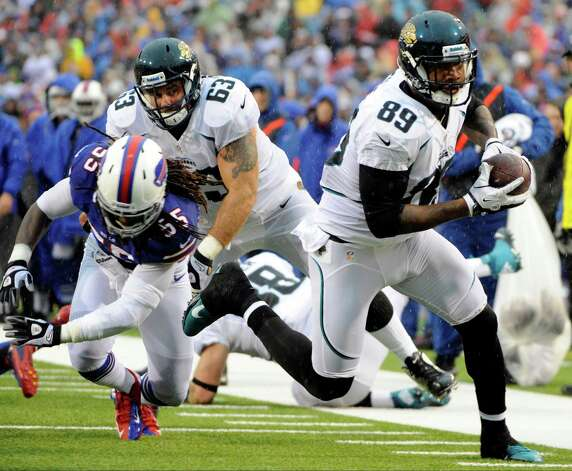Jacksonville Jaguars tight end Marcedes Lewis (89) runs away from Buffalo Bills linebacker Kelvin Sheppard (55) during the first half of an NFL football game on Sunday, Dec. 2, 2012, in Orchard Park, N.Y. (AP Photo/Gary Wiepert) Photo: Gary Wiepert