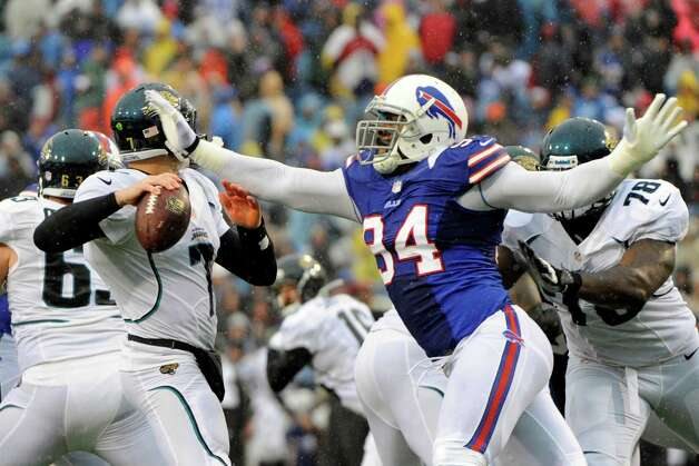 Buffalo Bills defensive end Mario Williams (94) knocks the ball away from Jacksonville Jaguars' Chad Henne (7) during the first half of an NFL football game on Sunday, Dec. 2, 2012, in Orchard Park, N.Y. Williams recovered the fumble on the play. (AP Photo/Gary Wiepert) Photo: Gary Wiepert