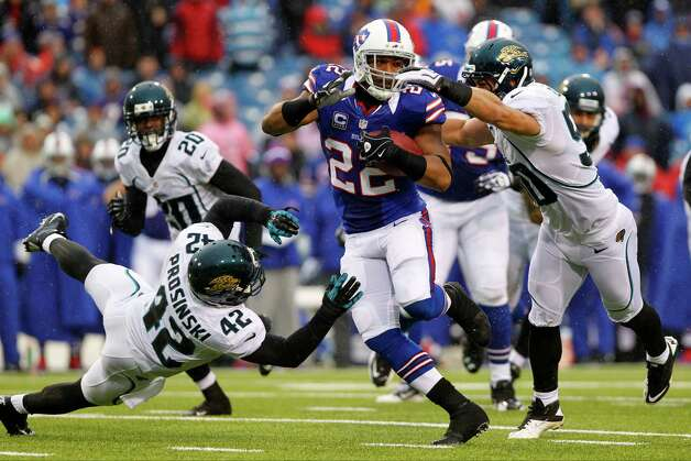 Buffalo Bills' Fred Jackson (22) runs away from Jacksonville Jaguars' Russell Allen (50) and Chris Prosinski (42) during the second half of an NFL football game, Sunday, Dec. 2, 2012, in Orchard Park, N.Y. (AP Photo/Bill Wippert) Photo: Bill Wippert