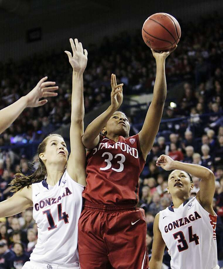 Amber Orrange works inside for a shot against Gonzaga's Sunny Greinacher (left), although Stanford did much of its damage from the outside. Photo: Young Kwak, Associated Press