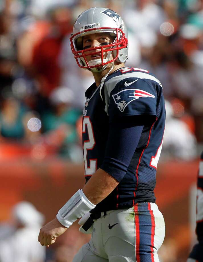 New England Patriots quarterback Tom Brady (12) leaves the field during the second half of an NFL football game against the Miami Dolphins, Sunday, Dec. 2, 2012, in Miami  (AP Photo/John Bazemore) Photo: John Bazemore