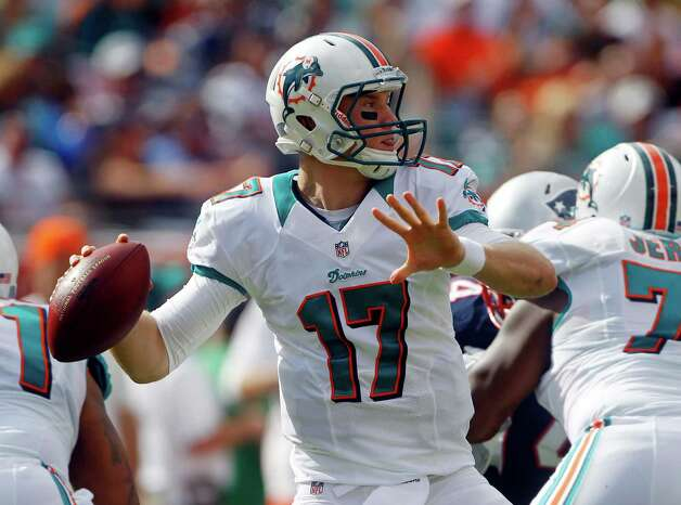 Miami Dolphins quarterback Ryan Tannehill (17) looks to pass during the first half of an NFL football game against the New England Patriots, Sunday, Dec. 2, 2012 in Miami. (AP Photo/John Bazemore) Photo: John Bazemore