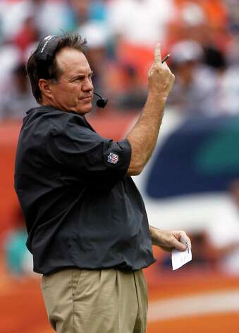New England Patriots head coach Bill Belichick gestures during the first half of an NFL football game against the Miami Dolphins, Sunday, Dec. 2, 2012 in Miami  (AP Photo/John Bazemore) Photo: John Bazemore