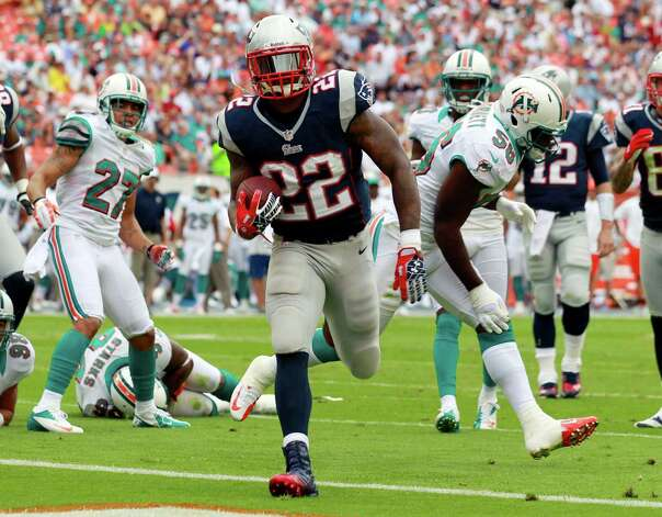 New England Patriots running back Stevan Ridley (22) scores a touchdown during the first half of an NFL football game against the Miami Dolphins, Sunday, Dec. 2, 2012 in Miami  (AP Photo/John Bazemore) Photo: John Bazemore
