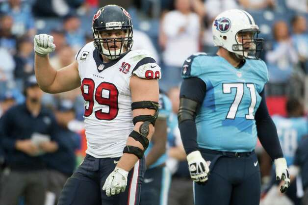 J.J. Watt celebrates a holding penalty call against the Titans as tackle Michael Roos looks on. Photo: Smiley N. Pool, Houston Chronicle / © 2012  Houston Chronicle