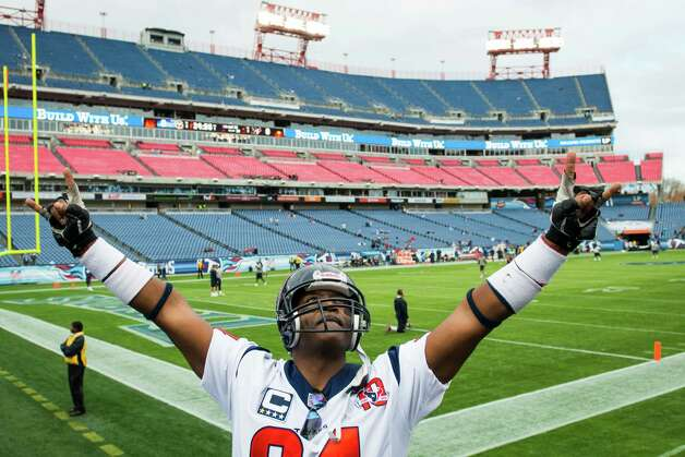Texans fan Herman Eagleton of Houston, gestures to other fans in the stadium as the teams warm up. Photo: Smiley N. Pool, Houston Chronicle / © 2012  Houston Chronicle