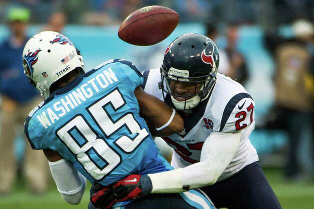 Quintin Demps puts a hard hit on Titans receiver Nate Washington, knocking a pass away to be intercepted by Darryl Sharpton in the fourth quarter. Photo: Smiley N. Pool, Houston Chronicle / © 2012  Houston Chronicle