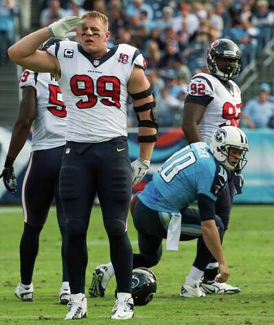 Texans defensive end J.J. Watt gives a celebratory salute after bringing down Titans quarterback Jake Locker. Photo: Smiley N. Pool, Houston Chronicle / © 2012  Houston Chronicle